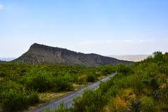 Bergmening vóór Kanhatti-Tuin spoedig Vallei Royalty-vrije Stock Afbeelding