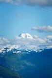 Bergpiek boven wolken Royalty-vrije Stock Foto's