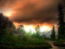 bergsolnedgång Arkivbild