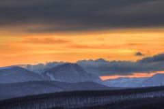 bergsolnedgång Arkivfoton
