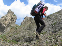 Bergsteiger auf Felsen Stockbilder