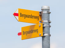Bergwanderweg sign in the mountains, navigation for hikers Stock Image