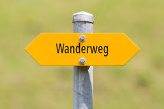 Bergwanderweg sign in the mountains, navigation for hikers Royalty Free Stock Photo