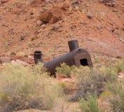 Bergwerksausrüstung der Verrottung in der Wüste Lizenzfreie Stockfotos