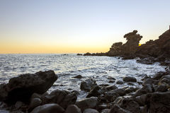 Berühmte Touristenattraktion in Jeju-Insel von Südkorea Ansicht des Drache-Hauptfelsens Yongduam alias während des Sonnenuntergan Stockbilder