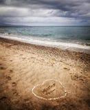 Bericht van een ontbrekende liefde in het zand Royalty-vrije Stock Foto's