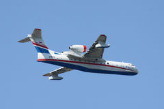 Beriev Be-200 amphibian plane. Gelendzhik, Russia - September 9, 2010: Beriev Be-200 amphibian plane is flying against clear sky Royalty Free Stock Photography