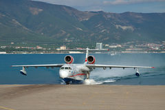 Beriev Be-200 amphibian plane. Gelendzhik, Russia - September 8, 2010: Beriev Be-200 amphibian plane is getting out of the water to land Royalty Free Stock Image