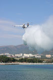 Beriev Be-200 amphibian plane. Gelendzhik, Russia - September 9, 2010: Beriev Be-200 amphibian planes is dropping a load of water to show its firefighting Stock Photos