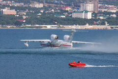 Beriev Be-200 amphibian plane. Gelendzhik, Russia - September 8, 2010: Beriev Be-200 amphibian plane is preparing for a takeoff from water surface Stock Photography