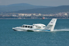 Beriev Be-103 amphibious plane. Gelendzhik, Russia - September 8, 2010: Beriev Be-103 amphibious plane is taking off from water surface of the bay royalty free stock photo