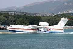 Beriev Be-200. Gelendzhik, Russia - September 8, 2010: Beriev Be-200 amphibian cargo and firefighter plane is getting out of the water to the ramp Stock Photos