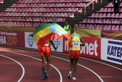 BERIHU AREGAWI and OLIKA ADUGNA from ETHIOPIA after 10 000 meters final on IAAF World U20 Championship. TAMPERE, FINLAND, July 10: BERIHU AREGAWI and OLIKA stock photography