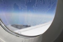 Berijpt vliegtuigvenster Stock Fotografie