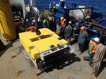 The Bering Sea / Russia - June 11 2016: Science expedition team on the stern of RV Akademik Lavrentyev preparing the ROV to deploy stock photo