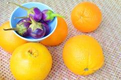 Beringela e laranjas violetas Imagens de Stock Royalty Free