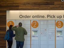 Two patrons using Amazon Locker stock images