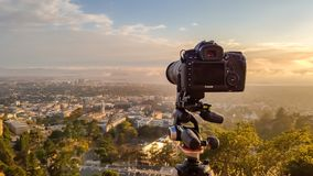 Canon 5D Mark IV on a Manfrotto tripod at Grizzly Peak in Berkeley Hills pointing at San Francisco covered with fog at sunset. Berkeley, United States - July 12 stock photo