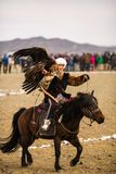 Berkutchi Kazakh Eagle Hunter in the mountains of Bayan-Olgii aimag of West Mongolia stock image