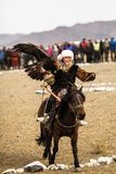 Berkutchi Kazakh Eagle Hunter in the mountains of Bayan-Olgii aimag of West Mongolia. OLGIY, MONGOLIA - SEP 30, 2017: Berkutchi Kazakh Eagle Hunter in the stock photos
