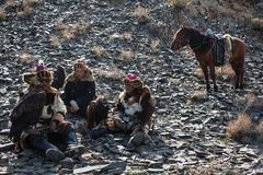 Berkutchi Kazakh Eagle Hunters in the mountains of Bayan-Olgii aimag of West Mongolia royalty free stock images