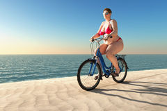 Überladene Frauenfahrt auf Fahrrad Stockfotos