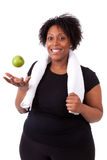 Überladene junge schwarze Frau, die einen Apfel - afrikanische Leute hält Lizenzfreie Stockfotografie