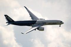 Airbus A350 XWB passenger jet aircraft. BERLIN - APR 27, 2018: New Airbus A350 XWB passenger jet plane in flight at the Berlin ILA Air Show stock image