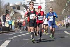 Berlin half marathon. BERLIN - APRIL 7: Participants of the thirty-third half marathon at km 14, 2013 in Berlin, Germany stock images