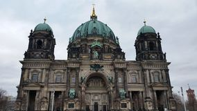 Berlin architecture. Incredible church in Berlin with copper roofs Royalty Free Stock Photo