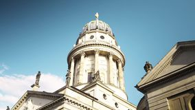 BERLIN - AUG 21: Real time pan shot of Gendarmenmarkt Church in Berlin, Germany. BERLIN - AUG 21: Real time left to right pan shot of Gendarmenmarkt Church in stock footage