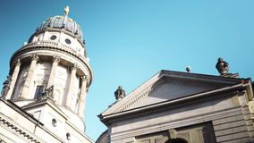 BERLIN - AUG 21: Real time slider shot of Gendarmenmarkt Church in Berlin, Germany. BERLIN - AUG 21: Real time right to left slider shot of Gendarmenmarkt Church stock video footage