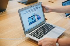 The buyer chooses to buy a new MacBook in the official store of Apple in Berlin. Berlin, August 29, 2018: The buyer chooses to buy a new MacBook in the official Royalty Free Stock Photo
