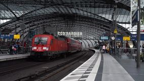 Berlin - August 21: Train departing from Berlin Central Station. Berlin - August 21: Red train leaving Berlin Central Station on a cloudy summer day, August 21 stock video