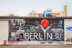 The Berlin wall Berliner Mauer with grafitti. BERLIN - AUGUST 22, 2017: The Berlin wall with grafitti on August 22, 2017 in Berlin, Germany. It was a barrier stock photography