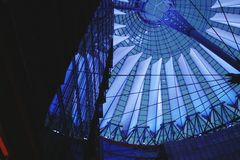 Berlin. Blue. Sony center. Potsdamer platz. Low angle view. Night. High Tech. Modern. Architecture. Construction stock image