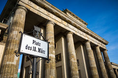 Berlin Brandenburg Gate with street sign Stock Photos
