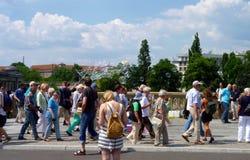 Street entertainer makes bubbles on a Berlin bridge. Stock Photos