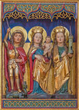 Berlin - The carved polychrome gothic altar with the Madonna, St. Barbara and St. George in  Dominicans church of St. Pauls Stock Photo