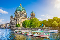 Berlin Cathedral with boat on Spree river at sunset, Germany. Beautiful view of Berliner Dom (Berlin Cathedral) at famous Museumsinsel (Museum Island) with