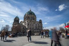 The Berlin Cathedral in German, `Berliner Dom`, designed by Julius Carl Raschdorff. People enjoying the warm afternoon in the Lu. Stgarten royalty free stock photos