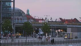 Berlin Central Railway Station Street Scene With Traffic. Berlin Central Railway Station, Train Arriving. People Walking On Street, Traffic. Summer Day At Sunset stock footage