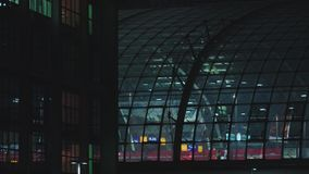 Berlin Central Station Impression At Night. Berlin Central Railway Station. Long Shot At Night, Buildings, Structures, Lights, Red Regional Train Departing. Male stock video footage