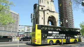 Berlin city west with traffic and tourist bus passing by. camera pan to Wilhelm Gedaechtniskirche stock video
