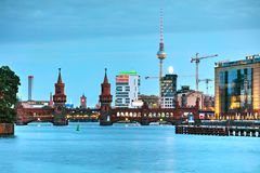 Berlin cityscape with Oberbaum bridge. In the evening royalty free stock photography