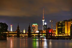 Berlin cityscape with Oberbaum bridge. In the evening royalty free stock photos