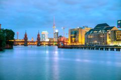 Berlin cityscape with Oberbaum bridge. In the evening Stock Photography