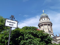 Berlin concert hall. Exterior of domed Concert hall with Gendarmenmarkt sign in foreground, Berlin, Germany Stock Images