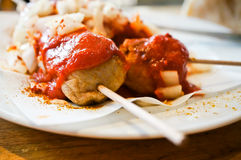 Berlin curry wurst. Closeup of an original Berlin curry wurst with onion and chili on a plate Stock Photography