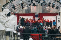 Christmas children`s choir on the open stage in the square in Berlin. stock photos